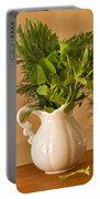 A Bouquet Of Fresh Herbs In A Tiny Jug Portable Battery Charger