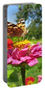 A Butterfly On The Pink Zinnia Portable Battery Charger