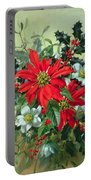 A Christmas Arrangement With Holly Mistletoe And Other Winter Flowers Portable Battery Charger