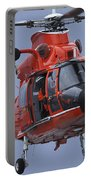 A Coast Guard Mh-65 Dolphin Helicopter Portable Battery Charger by Stocktrek Images