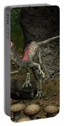 A Compsognathus Prepares To Swallow Portable Battery Charger by Walter Myers