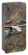 A Cv-22 Osprey Flies Over The Canyons Portable Battery Charger by Stocktrek Images