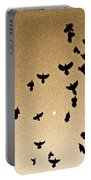 A Flight Of Grackles Circling The Moon Portable Battery Charger