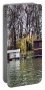 A Raft Houses Moored To The Shoreline Of Ada Medjica Islet Portable Battery Charger