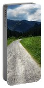 A Stone Path Through The Countryside Into The Forest Portable Battery Charger