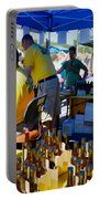 A Vendor At The Garlic Fest Offers Garlic Vinegar And Olive Oil For Sale Portable Battery Charger