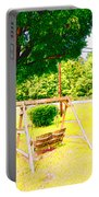 A Wooden Swing Under The Tree Portable Battery Charger