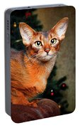Abyssinian Cat In Christmas Tree Background Portable Battery Charger