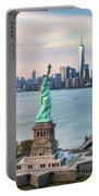 Aerial Of The Statue Of Liberty At Sunset, New York, Usa Portable Battery Charger