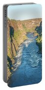 Aerial View Of Sunlit Rapids In Canyon Portable Battery Charger