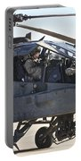 Ah-64d Apache Longbow Pilot Prepares Portable Battery Charger
