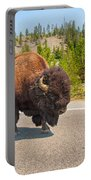 American Bison Sharing The Road In Yellowstone Portable Battery Charger