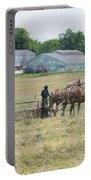 Amish Girl Raking Hay As Painting Portable Battery Charger