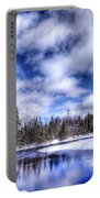 An Adirondack Winter Portable Battery Charger