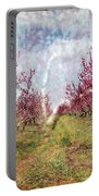 An Orchard In Blossom In The Golan Heights Portable Battery Charger