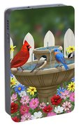 The Colors Of Spring - Bird Fountain In Flower Garden Portable Battery Charger by Crista Forest