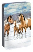 Buckskin Paint Horses In Winter Pasture Portable Battery Charger