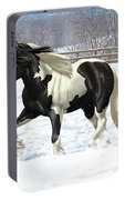 Black Pinto Gypsy Vanner In Snow Portable Battery Charger by Crista Forest
