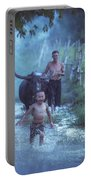 Asian Boy Playing Water With Dad And Buffalo Portable Battery Charger