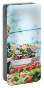 Attractive Gardener Selecting Flowers In A Gardening Center. Portable Battery Charger