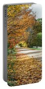 Autumn Road With Fence  Portable Battery Charger