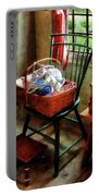 Basket Of Cloth And Yarn On Chair Portable Battery Charger