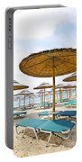 Beach Umbrellas And Chairs On Sandy Seashore Portable Battery Charger