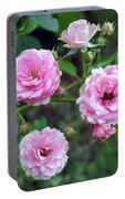 Beautiful Delicate Pink Roses On Green Leaves Background. Portable Battery Charger
