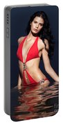 Beautiful Young Woman In Red Swimsuit Standing In Water Portable Battery Charger