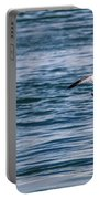 Bird In Flight Over Water Portable Battery Charger
