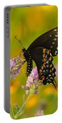 Black Swallowtail Portable Battery Charger by Robert Frederick