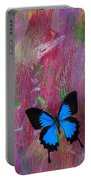Blue Butterfly On Colorful Wooden Wall Portable Battery Charger