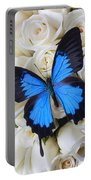 Blue Butterfly On White Roses Portable Battery Charger