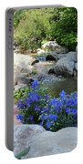 Blue Flowers And Stream Portable Battery Charger