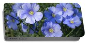 Blue Flowers In The Sun Portable Battery Charger