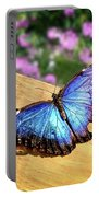 Blue Morpho Butterfly On A Wooden Board Portable Battery Charger