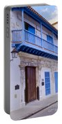 Blue Trim On White Building Portable Battery Charger