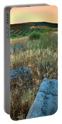 blue stones amongst the olive groves near Iznajar Andalucia Spain Portable Battery Charger