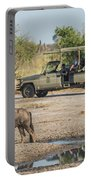 Blue Wildebeest Beside Puddle With Jeep Behind Portable Battery Charger