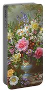 Bluebells Daffodils Primroses And Peonies In A Blue Vase Portable Battery Charger