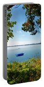 Boat Framed By Trees And Foliage Portable Battery Charger