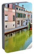 boat in a canal of the colorful italian village of Comacchio in  Portable Battery Charger