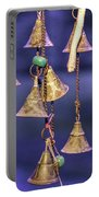 Brass Bells Hanging In The Illuminated Courtyard At Winter Night Portable Battery Charger