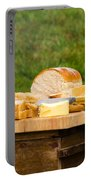 Bread With Butter On Cutting Board Portable Battery Charger