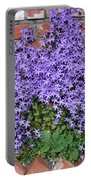 Brick Wall With Blue Flowers Portable Battery Charger