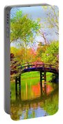 Bridge With Red Bushes In Spring Portable Battery Charger