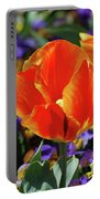 Bright And Colorful Orange And Red Tulip Flowering In A Garden Portable Battery Charger