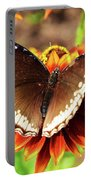 Butterfly On A Sunset Portable Battery Charger