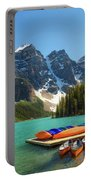 Canoes On A Jetty At  Moraine Lake In Banff National Park, Canada Portable Battery Charger