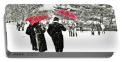 Central Park Snow And Red Umbrellas Portable Battery Charger